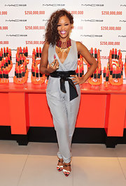 Eve looked chic and sexy at the International AIDS Conference in a sleeveless low-cut jumpsuit cinched with a leather belt.