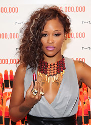 Eve looked dramatic at the International AIDS Conference with her hair in tight curls and a side sweep.