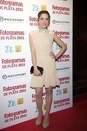 Posing on the red carpet at the Fotogramas Awards in Madrid, Maria Leon cut a demure figure in this pretty high-neck dress.