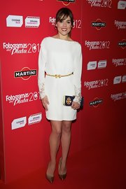 Adriana Ugarte opted for a classic white dress with lace detailing on the sleeves.