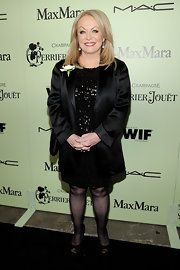 Jacki sparkled in a black sequined cocktail dress under a satin blazer at the pre-Oscar party.