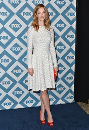 Judy Greer's red platform peep-toes injected a welcome pop of color into her look.