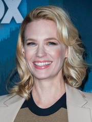 January Jones styled her silken locks with soft waves and retro bangs swept to one side for the Fox All-Star party.