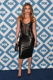 Jennifer Lopez looked fiercely seductive at the Fox All-Star party in a black Ermanno Scervino leather dress with a mesh-panel bodice.