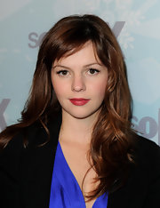 Amber Tamblyn drew attention to her pout with matte berry lipstick.