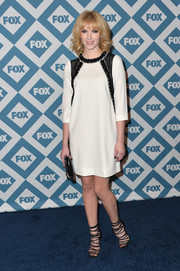 Claudia Lee went for mod elegance at the Fox All-Star party in a black-and-white shift dress with an embellished bodice.
