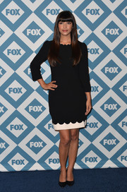 Hannah Simone donned a little black dress, featuring scalloped detailing and a strip of white at the hem, for the Fox All-Star party.