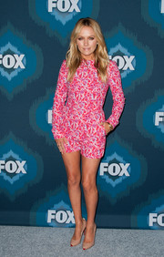 Becki Newton got playful with her Fox All-Star party look, wearing a vibrant pink letter-motif romper by Mary Katrantzou.