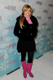 Mary Murphy went for a playful cold weather look in candy pink knee high boots.