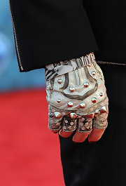 Adam Lambert rocked a pair of leather studded fingerless gloves on the red carpet for the 'American Idol' results show.