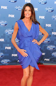 Janice looked flawless at the 'American Idol' finale show wearing a wrap around lilac dress.