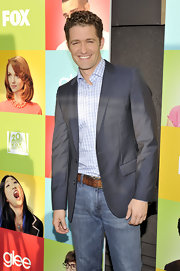 Matthew paired his classic jeans with a grey blazer.