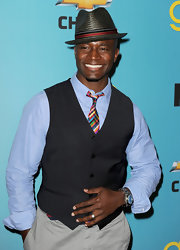 Taye Diggs gave his look some flair with a straw fedora.