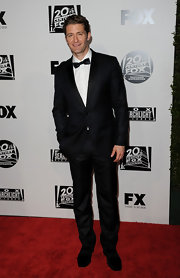 Matthew looked sharp in a classic suit and bow tie.