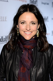 Julia Louis-Dreyfus sported a casual center-parted wavy 'do when she attended the Fox Searchlight TIFF party.