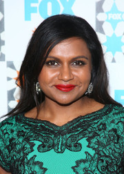 Mindy Kaling's red lipstick provided a striking contrast to her green outfit.