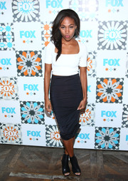 Nicole Beharie teamed her top with a black pencil skirt for a stylish monochrome look.