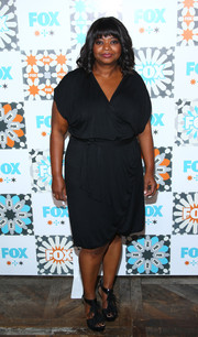 Octavia Spencer paired feather-embellished T-strap platform sandals with a faux-wrap LBD for the Fox Summer TCA All-Star Party.