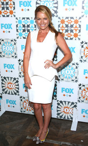 Becki Newton styled her dress with a pair of tricolor printed pumps.