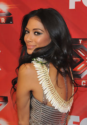 Nicole Scherzinger added dramatic sweeps of glittery black liner to create her glamorous look at 'The X Factor' season finale.