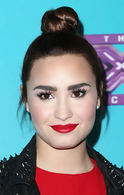 Demi wore her hair up in a tight top knot for the 'X-Factor' finalist party.