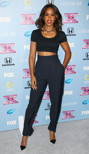 Kelly Rowland looked sporty and trendy in a black crop-top during the 'X Factor' finalist party.