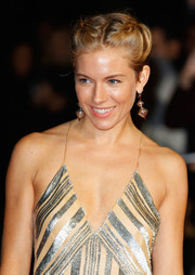 Sienna Miller stuck to her boho roots with a braided updo at the London premiere of 'Foxcatcher'.