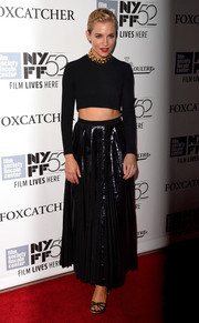 Sienna Miller wore strappy black sandals to the Foxcatcher Premiere at the 52nd New York Film Festival.