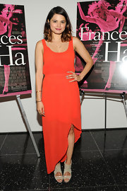 Melonie Diaz chose a tangerine asymmetrical-hemmed maxi for her look at the NYC premiere of 'Frances Ha.'