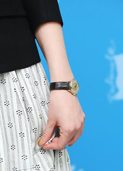 Greta Gerwig accessorized with an elegant leather-band quartz watch at the Berlinale International Film Festival.