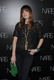 Lake Bell attended the Nars book celebration wearing a Global leather bracelet in black diamond crystals and moss green and tortoise resin in matte gold.
