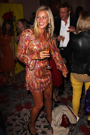 Holly Branson showed off her legs in a short print dress with flare sleeves.