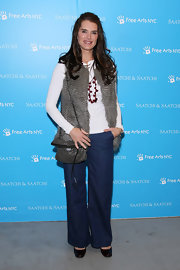 Brooke Shields paired her casual ensemble with a silver chainmail flap bag. The chain strap purse also features a long tassel.