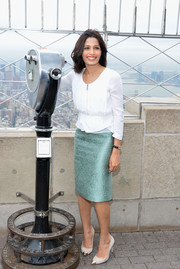 Freida Pinto looked fab in an iridescent blue jacquard pencil skirt by Burberry Prorsum paired with a white peplum top during her visit to the Empire State Building.