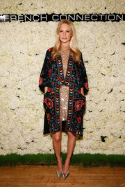 Poppy Delevingne was hippie-glam in a French Connection paisley-print coat layered over a sequined dress during the label's collection preview party.