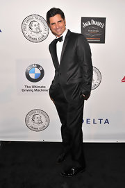 John Stamos looked suave as ever in this classic tuxedo and bow tie.