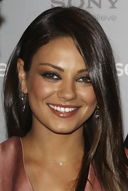 Starlet Mila Kunis opted for a gunmetal gray shadow to pair with her Lanvin frock.