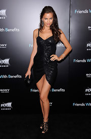 Russian bombshell Irina Shayk wore a sexy black number to the 'Friends with Benefits' premiere in New York. She finished off the sultry look with tousled curls and fierce heels.