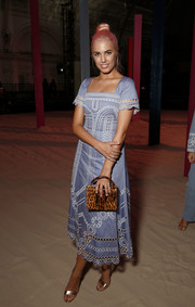 Amber Le Bon cut a sweet figure in a blue broderie anglaise dress by Temperley London during the brand's fashion show.