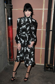 Daisy Lowe paired her frock with black cross-strap platform sandals.