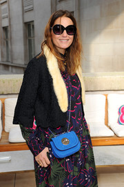 Yasmin Le Bon headed to the Hill and Friends presentation carrying a bright blue suede bag from the brand.