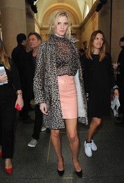 Lara Stone topped off her ensemble with a leopard-print coat.