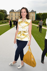 Pamela Golbin chose a yellow floral blouse to team with her leggings.