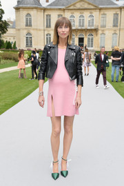 Anya Ziourova toughened up a pink mini with a black leather moto jacket for the Dior Couture fashion show.