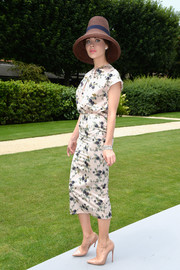 Ulyana Sergeenko was demure and chic in a floral silk blouse during the Dior Couture fashion show.