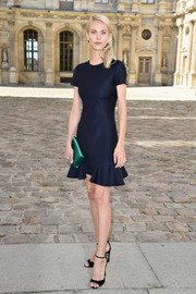 Aymeline Valade's emerald-green satin clutch provided a lovely color contrast to her navy dress.