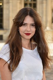 Giovanna Meneghel left her long hair loose with center-parted bangs when she attended the Dior fashion show.