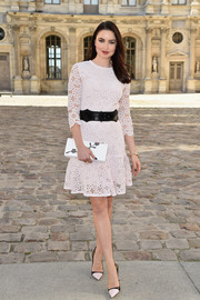 Emma Miller went for demure elegance in a pale-pink lace dress during the Dior fashion show.