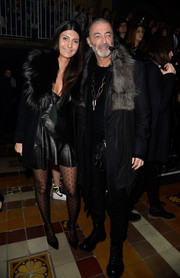 Giovanna Battaglia teamed a black fur-collar jacket with a flirty leather dress for the Lanvin fashion show.