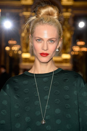 Aymeline Valade's bold red lip provided a striking contrast to her green outfit.